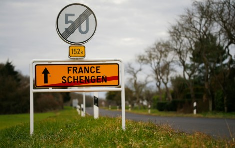 A street sign marks the beginning of France and the end of Schengen